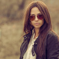 Outdoor fashion portrait of brunette woman in sunglasses outdoors Stock Photos