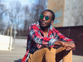 Outdoor fashion portrait of stylish young african man Royalty Free Stock Photo