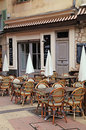 Outdoor french cafe traditional with old wood tables and wicker chairs in old town of nice riviera france Royalty Free Stock Photography