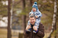 Outdoor fun father and son having outdoors shallow depth of field Royalty Free Stock Photo