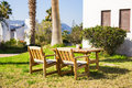 Outdoor furniture. Lounge chairs in hotel garden invite you to relax Royalty Free Stock Photo
