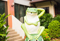 Outdoor garden decoration statue frog green funny Royalty Free Stock Photo
