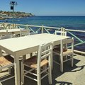 Outdoor greek cafe terrace overlooking the sea, Crete, Greece Royalty Free Stock Photo