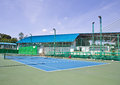 Outdoor hard court tennis against blue sky Royalty Free Stock Photo