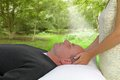 Outdoor healing session soft blur background female healer channeling to male client during Stock Images