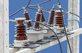 Outdoor High Voltage Instrument Transformers isolated on blue ba Royalty Free Stock Photo