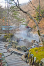 Outdoor hot spring with stone walk path, Onsen in japan Royalty Free Stock Photo