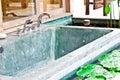 Outdoor jacuzzi bathtub in garden 1 Stock Images