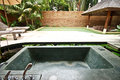 Outdoor jacuzzi bathtub in garden 4 Royalty Free Stock Images