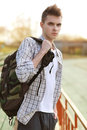 Outdoor lifestyle portrait of handsome guy with backpack Royalty Free Stock Photo