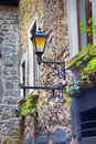 Outdoor lighting quaint lantern style light on old european building Stock Images