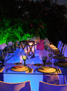 Outdoor Modern Restaurant, Lighted Candles and Tables, White Napkins, Funny Table Set
