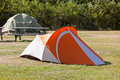 Outdoor orange tourist tent at camping field horizontal shot Stock Images