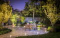 Outdoor patio illuminated at night Royalty Free Stock Photo