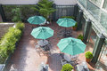 Outdoor Patio Seatings with Umbrellas Royalty Free Stock Photo