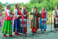 Outdoor performance of women singers wearing ukrainian ethnic traditional clothes and celebrating pagan holiday of Ivan Kupala Royalty Free Stock Photo