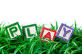Outdoor play alphabet blocks forming on a patch of grass Royalty Free Stock Images