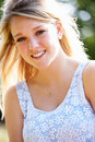 Outdoor portrait of attractive teenage girl close up smiling Royalty Free Stock Photo