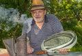 Outdoor portrait of bearded elderly man bee-keeper Royalty Free Stock Photo