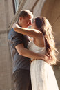 Outdoor portrait of beautiful couple young kissing on the street Stock Images