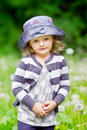 Outdoor portrait of a beautiful little girl in summer field vertical Royalty Free Stock Photo