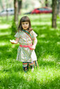 Outdoor portrait of a cute little girl in dress. Royalty Free Stock Photo