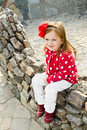 Outdoor portrait  of cute sitting little girl Stock Image