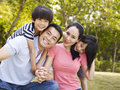 Outdoor portrait of happy asian family Royalty Free Stock Photo