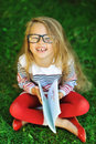 Outdoor portrait of laughing sweet little girl in a park Royalty Free Stock Image
