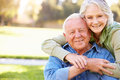 Outdoor portrait of loving senior couple holding each other smiling Royalty Free Stock Photos