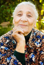 Outdoor portrait of one elegant senior woman Stock Photo