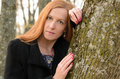 Outdoor portrait of red haired woman with green eyes. A young wo Royalty Free Stock Photo