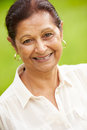 Outdoor portrait of senior indian woman smiling at camera Stock Photography