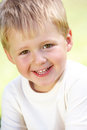 Outdoor Portrait Of Smiling Young Boy Royalty Free Stock Photo