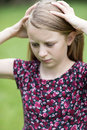 Outdoor Portrait Of Stressed Young Girl Royalty Free Stock Photo