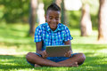 Outdoor portrait of student black boy using a tactile tablet african people Royalty Free Stock Photos