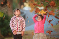 Outdoor portrait of two young happy children, girls - sisters - Royalty Free Stock Photo