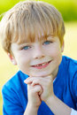 Outdoor portrait of young boy in countryside looking to camera smiling Royalty Free Stock Photography