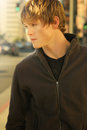 Outdoor portrait young casual man city warm golden light Stock Photo