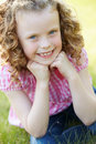 Outdoor portrait of young girl in countryside smiling at camera Royalty Free Stock Photos