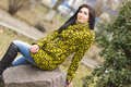 Outdoor portrait of young pretty beautiful woman in cold spring weather in park sensual brunette posing and having fun Royalty Free Stock Image
