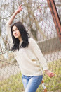 Outdoor portrait of young pretty beautiful woman in cold spring weather in park sensual brunette posing and having fun Royalty Free Stock Photo