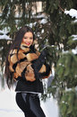 Outdoor portrait of young pretty beautiful woman in cold winter wearing fur coat outdoors Stock Photos