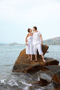 Outdoor portrait young romantic couple embracing stone azure waters phuket island thailand Stock Image