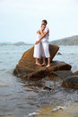 Outdoor portrait young romantic couple embracing stone azure waters phuket island thailand Royalty Free Stock Image