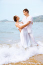 Outdoor portrait young romantic couple white cotton clothes embracing each other beach phuket island thailand Stock Photo