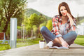 Outdoor relaxation concept with beautiful woman reading a book Royalty Free Stock Photo
