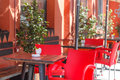 Outdoor restaurant with red tables and chairs Royalty Free Stock Photo