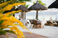 Outdoor restaurant tables on perfect sand beach Royalty Free Stock Photography