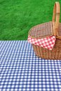 Outdoor Rustic Picnic Table With Hamper And Blue Tablecloth Royalty Free Stock Photo